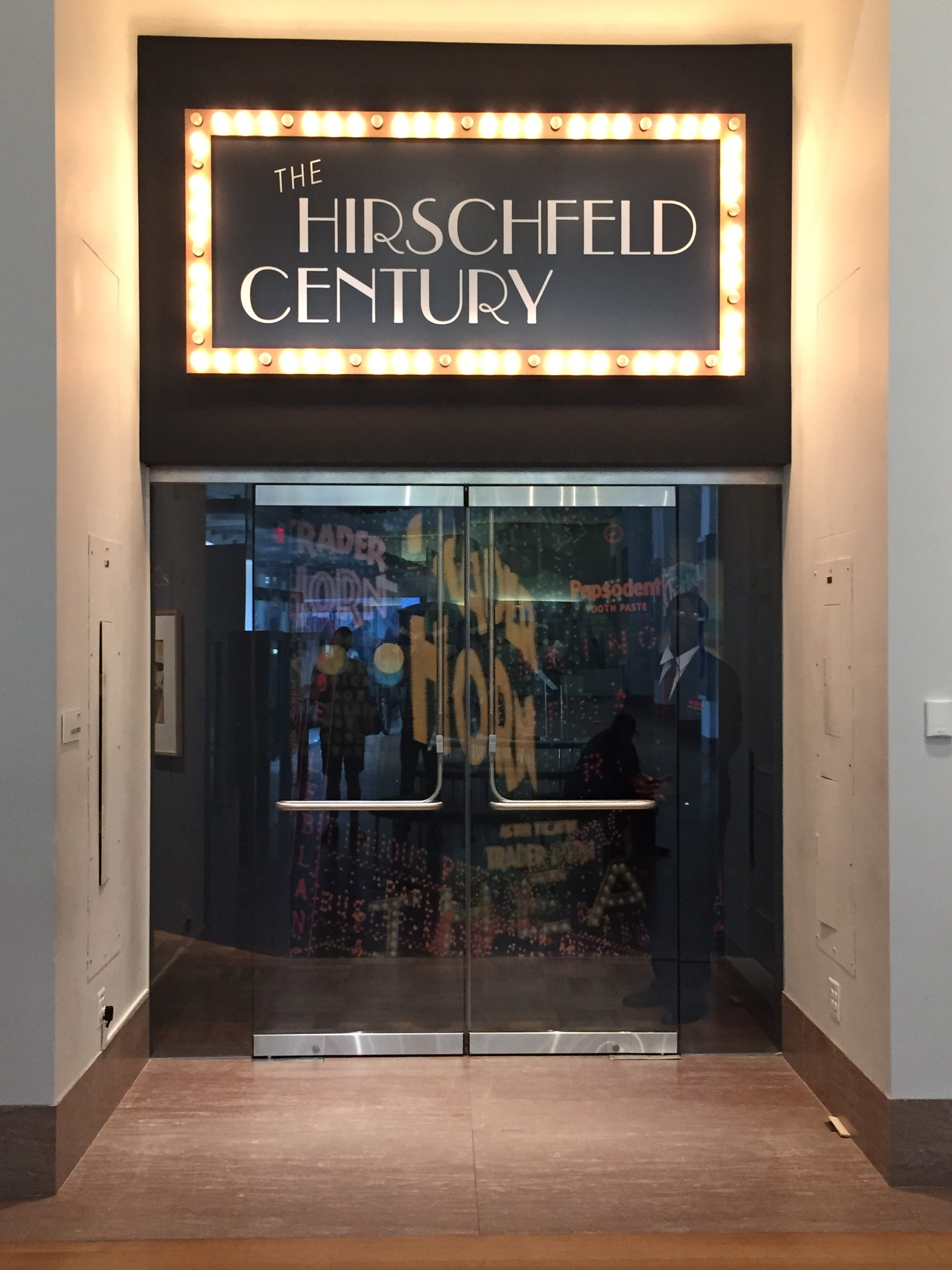 Photo of a door with the sign The Hirschfeld Century