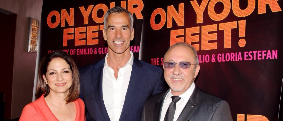 Emilio and Gloria Estefan with Jerry Mitchell at a press event for On Your Feet! the Broadway musical
