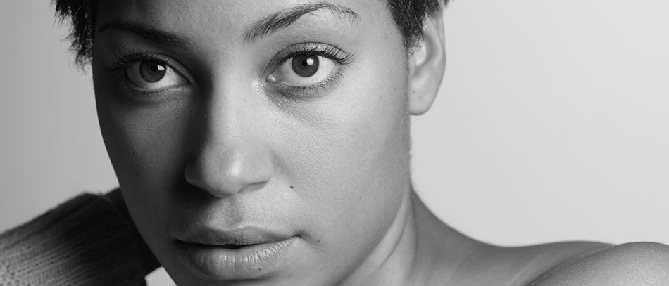 A headshot of Cush Jumbo