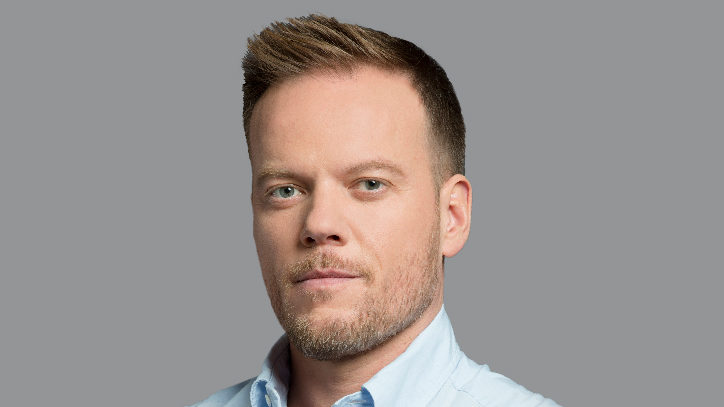 A headshot of Jason Moore