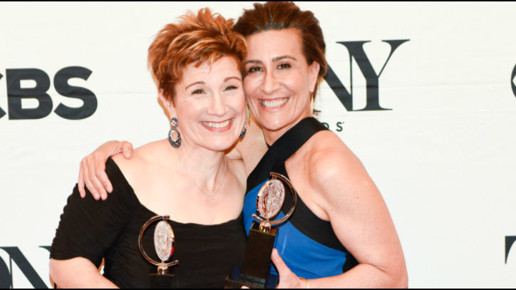 Lisa Kron and Jeanine Tesori hold their Tony Awards for their musical Fun Home