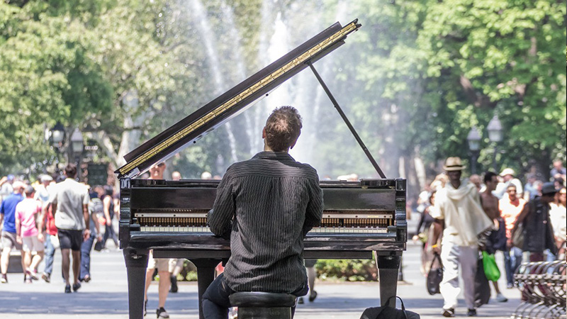 Guy playing the piano in Washington Square Park