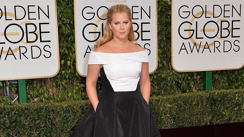 Amy Schumer walking the red carpet at the Golden Globe Awards