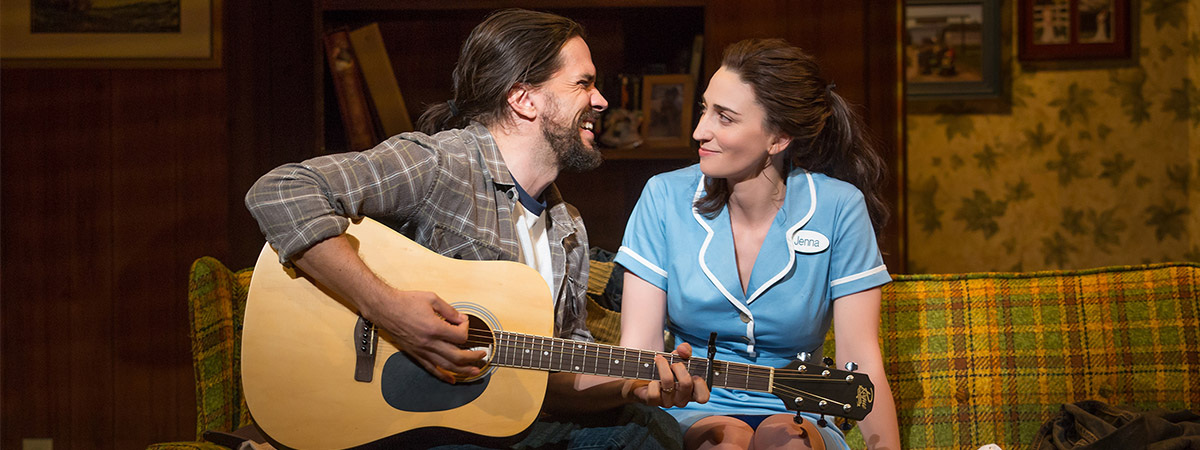Will Swenson playing guitar and singing to Sara Bareilles in the Broadway musical Waitress.