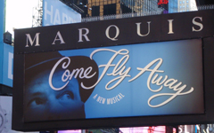 Marquis Theatre marquee, featuring Come Fly Away on Broadway