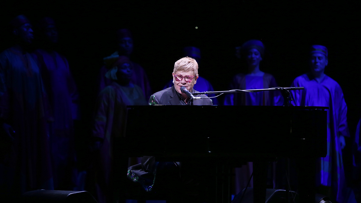 Elton John performs during the 20th Anniversary performance of Disney's The Lion King on Broadway