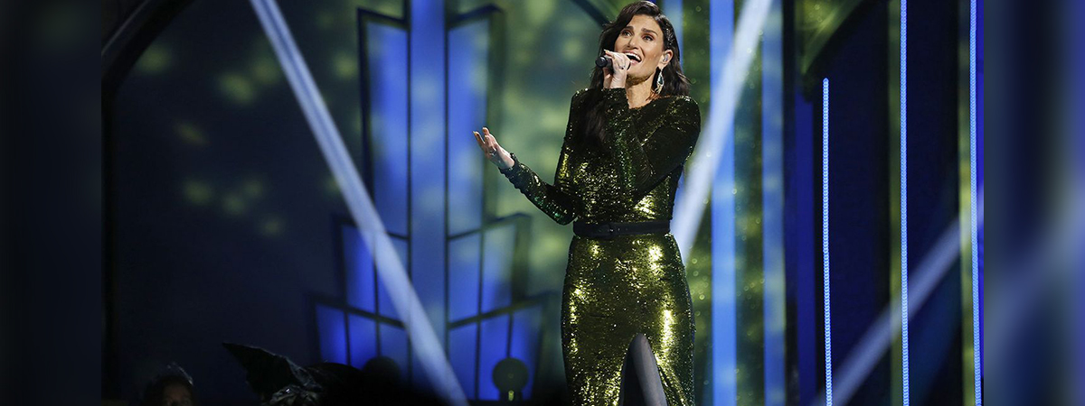 "Idina Menzel performs ""Devying Gravity"" in a green sequin dress during the NBC telecast of ""A Very Wicked Halloween"""