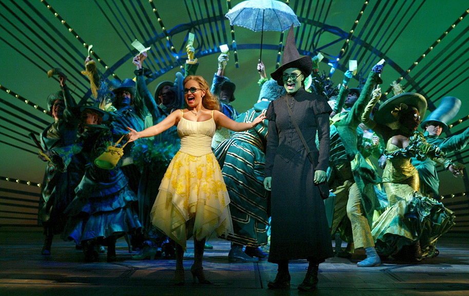 Kristin Chenoweth, Idina Menzel, and the original Broadway cast of <i>Wicked</i>.