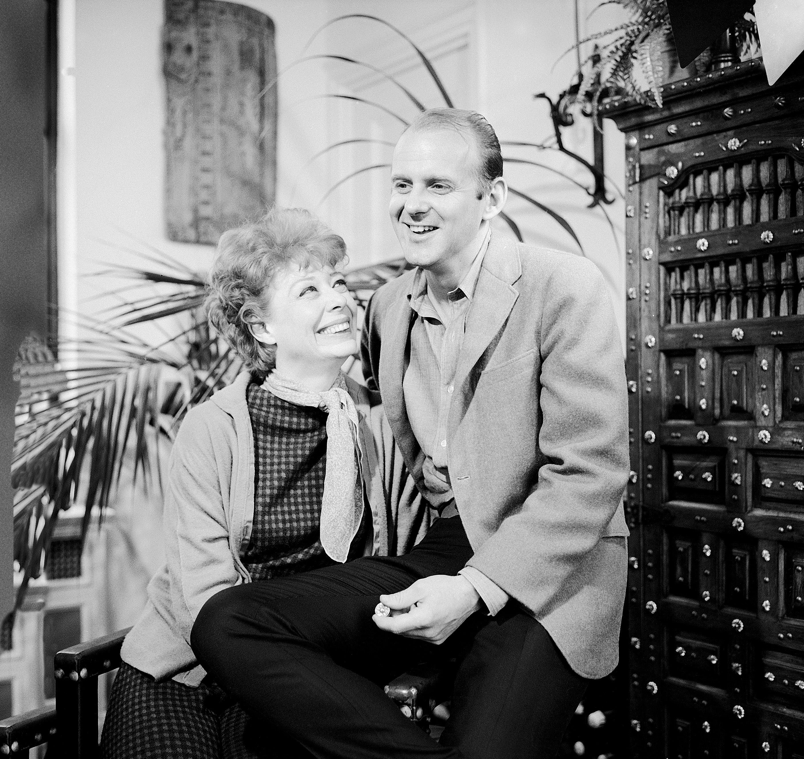 Gwen Verdon and Bob Fosse sitting together.