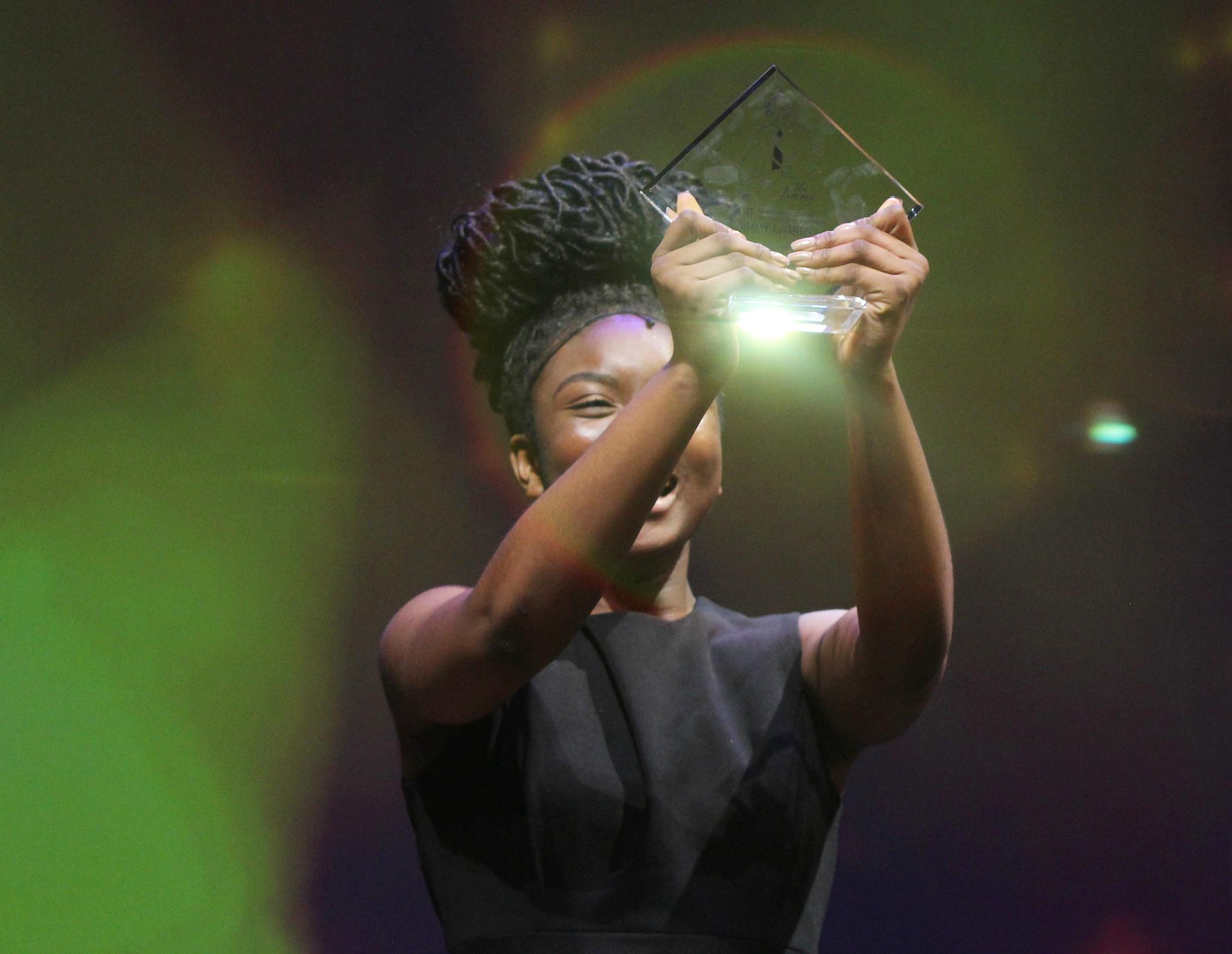 Ekele Ukegbu accepting her Jimmy Award. Photo by Henry McGee/NHSMTA