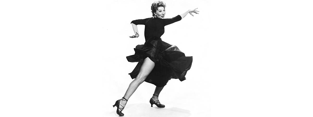 Gwen Verdon in a black dress, dancing