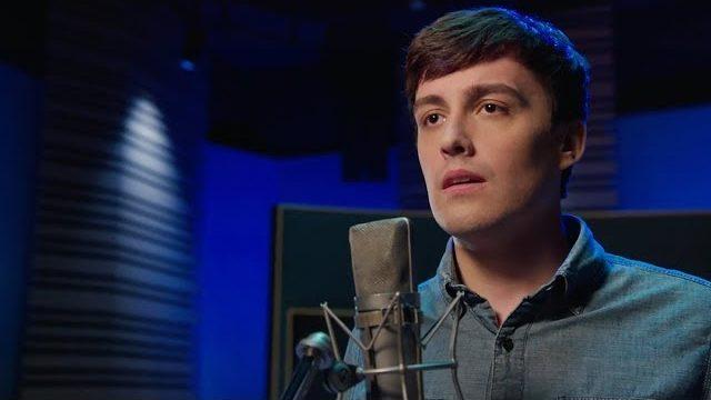 Evan from the Toronto Production of Dear Evan Hansen singing in a dark recording studio
