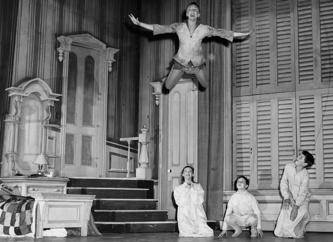 Mary Martin and the Darling children from Peter Pan.