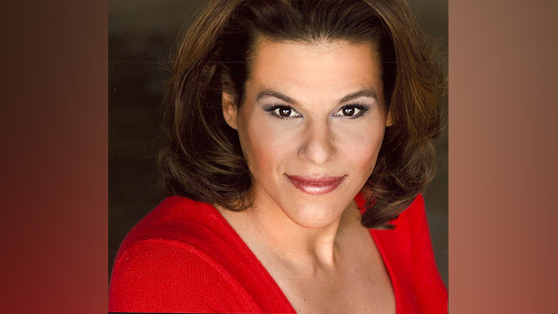 Alexandra Billings in a red shirt