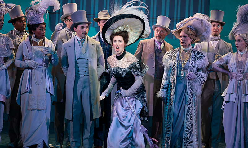 Sam Simahk, Shereen Ahmed, Kevin Pariseau, and Leslie Alexander in the national tour of <i>My Fair Lady</i>. Photo by Joan Marcus.