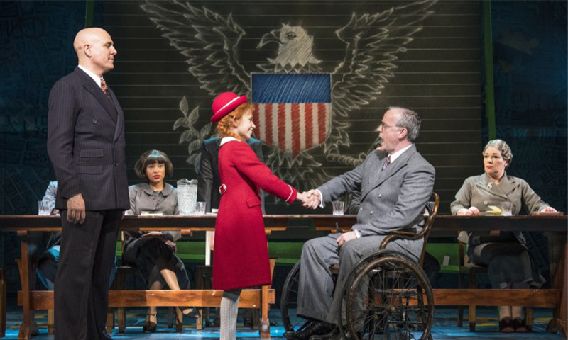 "Alex Bourne, Ruby Stokes, and Russell Wilcox in the West End production of ""Annie"" (Paul Coltas)"