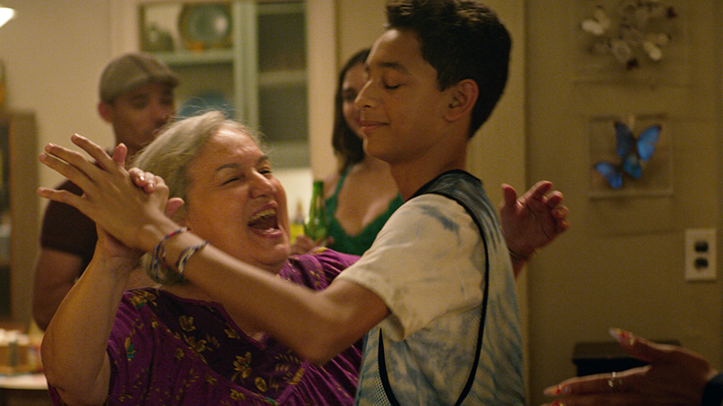 Olga Merediz as Abuela Claudia and Gregory Diaz IV as Sonny in Warner Bros. Pictures' <i>In the Heights</i>, a Warner Bros. Pictures release. Photo courtesy of Warner Bros. Pictures.