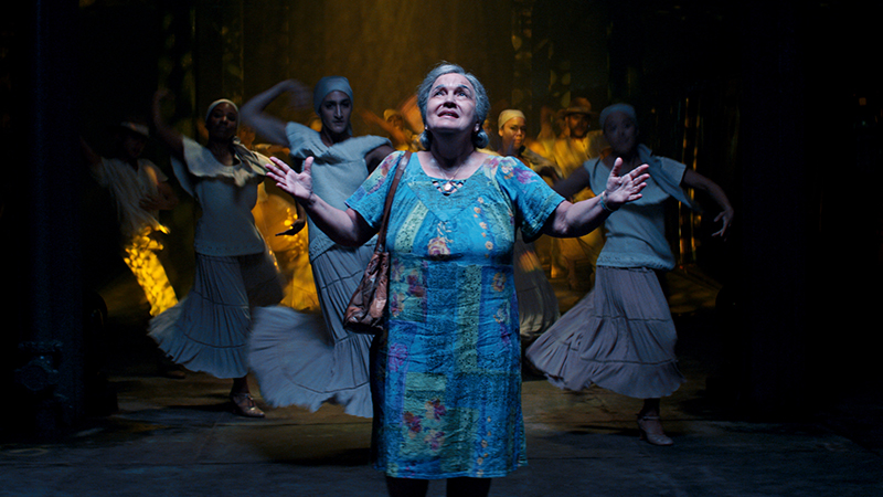 Olga Merediz (center) as Abuela Claudia in Warner Bros. Pictures' <i>In the Heights</i> a Warner Bros. Pictures release. Photo courtesy of Warner Bros. Pictures.